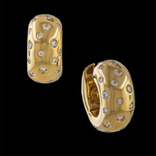 A great fashion accessory describes these 18 karat yellow gold huggie earrings by Simon Sobie. The earrings are set with a total of forty six round brilliant cut diamonds. The diamonds have a total weight of 0.81 carats. The diamonds average VS in clarity and F/G in color. The earrings measure 8.9mm in width.