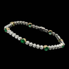 Exquisite 18kt white and yellow gold diamond and emerald bracelet.  The piece is set with 2.0ct of gem emeralds and 2.80ct of VS G-H quality diamonds.