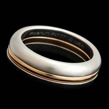 Steven Kretchmer's Inner Secrets 18kt rose gold band.  This can be engraved on the inside and is priced as the center band only size 6.