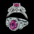 This three stone engagement ring from Spark is set with a 1.60ct oval pink sapphire center and 2 oval diamonds weighing 0.34 carats in total flanking. The 18kt white gold ring also is set with additional diamonds weighing 0.51 carats in total.