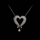 "This is the elegant ""Heart and Soul"" diamond and pearl necklace.  Beautiful pave set diamonds shaped in a heart with a tiny pearl dangling from the bottom."