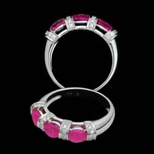 Exclusive from the Pearlman's collection, this lovely 18K white gold band shines with three round pink sapphires (1.32ct.tw.) seprated by .21cts. in diamonds. Lovely on its own or as part of an engagement set.