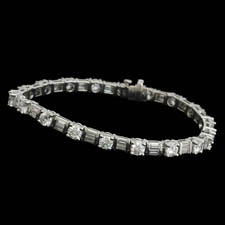 Exquisite platinum diamond bracelet. The piece is set with 6.65ct of round and baguette diamonds. VS G-H quality. Other sizes available.