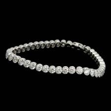 Elegant 18kt white gold diamond straight line bezel set bracelet.  The piece is set with 46 diamonds weighing 9.08ct. VS-G-H quality. Available in platinum.