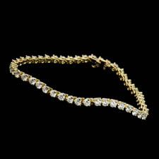 Beautiful 18kt gold diamond 3 prong bracelet.  The piece contains 4.11ct of diamonds of VS G-H quality diamonds. Available in platinum.