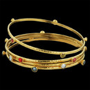 24K gold Gurhan 4mm Skittle Bangles. The price shown is for the white diamond version. The bracelets are also available in black diamond at $3,600.00 and tanzanite and poppy topaz at $3550.00.