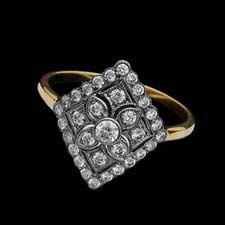 This whimsical and lovely 18K yellow and white gold ring fetures a floral diamond design (.48cts.tw.).