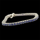 A timeless 14kt white gold Sapphire straight line (tennis) bracelet. This piece is set with 52 gem Swiss diamond cut natural Ceylon Sapphires weighing 5.26ct total. Each is perfectly matched and set in a heavy handmade 3.3mm width x 4.25mm depth line bracelet. Very difficult to match a bracelet like this today and one of a kind.