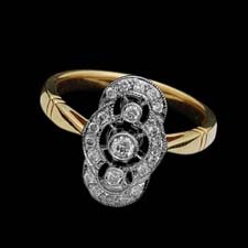 This lovely Deco-inspired 18K yellow gold ring is set with .23cts. in diamonds.