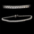 "Our classic 18kt white gold diamond line ""tennis"" bracelet. This is a handmade piece set with 2.25ct of VS+ F-G ideal cut diamonds. There are none made any finer. The bracelet is 7 1/4 "" in length, 2.9mm width, and 3.25mm height. Workmanship is incredible. Available in all diamond weights, yellow gold, and platinum. Made in the America."