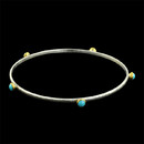 Skittle bracelet in sterling silver with 24k accents set with turquoise.