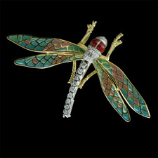 This beautiful Dragon Fly brooch is done in 18kt yellow gold with plique d'jour wings and a diamond body.  The piece measures 40mm in length and 70mm in width.