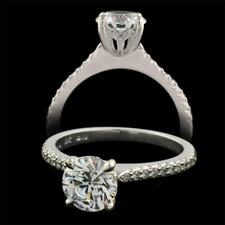 A wonderful 18kt white gold Petite Touch Collection engagement ring. The piece is set with 20 diamonds weighing .14ct total. VVS E-F quality. The ring measures 1.8mm in width. This ring is very petite and perfect for a 1/2ct and larger diamond. This is one amazing setting job. Diamonds are 1/2 way around the ring.
