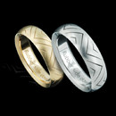 Before Steven passed away he designed these wedding bands, ''Rubber side down'', for his love of motorcycles.  These are platinum and 18kt gold and are 6mm each. It is our honor to present these for our friend Steven. Starting in size 7.