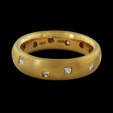 This beautiful 18kt yellow gold Confetti band is sprinkled with princess cut diamonds around the entire band.  The band measures 5mm wide and has a total diamond weight of .34ct.