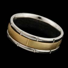A tailored two tone 18kt gold band measuring 7.0mm in width.  Available in  all white or yellow and platinum.