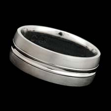 A very smart looking 18kt white gold 8mm textured band.  Available in yellow gold and platinum.