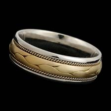 A favorite of ours!  This is a wonderful 18kt two tone gold 7mm wide band.  Available in all white and yellow gold and platinum.