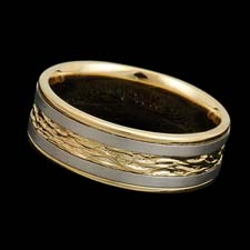 A beautifully engraved 18kt gold two tone band measuring 7.0mm in width. Available in all white or yellow gold and platinum.