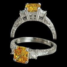A Michael Beaudry platinum Adia Diamond ring. The ring is set with one 1.14ct Fancy Vivid Orange Yellow Adia diamond. The stone is a SI2. The mounting contains .36ct of white diamonds. This was a custom created piece, please call for comparison pricing information.