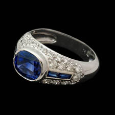 Wonderful platinum sapphire and diamond Gumuchian ring. The piece is set with a center 2.70ct gem blue sapphire with .35ct of blue sapphire baguettes. The diamonds weigh .80ct total. 12mm width