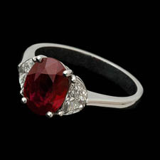 Beautiful handmade platinum diamond and ruby ring.  This ruby is a 2.35ct with .53ct of half moon shaped diamonds.  Most sizes available.