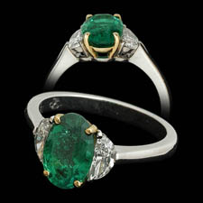 Pretty handmade platinum emerald and diamond 3 stone ring. This piece is set with a 1.81ct emerald and .53ct of 1/2 moon diamonds.  Can be made to most sizes.