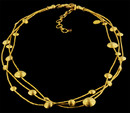 Triple strand 24k gold Lentil Rain Necklace from Gurhan. Mixed size lentils. Longest strand: 18'', shortest strand: 16'' extension chain. Ruby accents at lobster clasp.