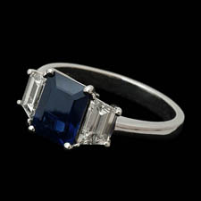 Classic sapphire and diamond 3 stone ring in platinum. This ring is set with a 1.62ct sapphire and 1.08ct side diamonds.  Available in most sizes.